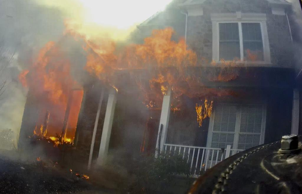Fire conditions upon arrival.  Photo from Lt. Ora's helmet just prior to making entry