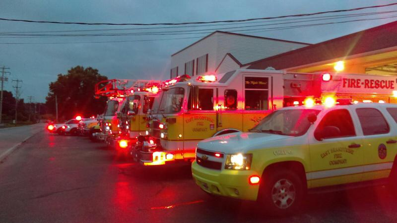Truck lined up just before daybreak to help send Mike off